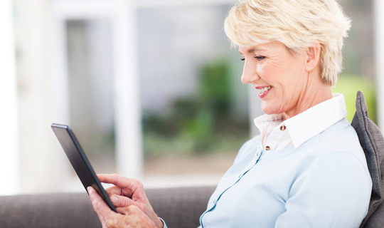 user reading axxess blog on tablet