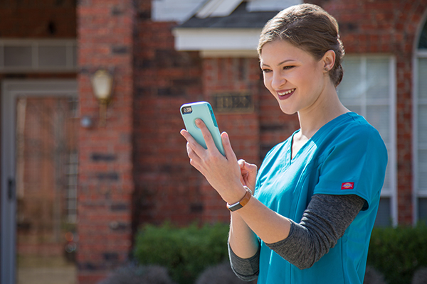 clinician using axxess homecare app on mobile device