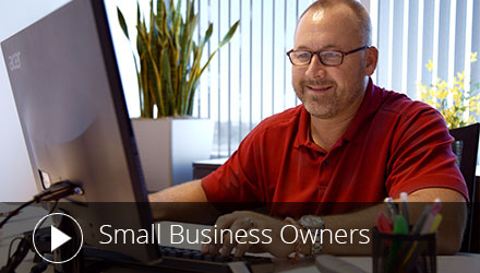 A small business owner using a computer.