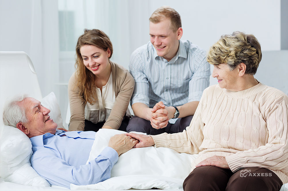 A hospice patient happy to see his family at his bedside