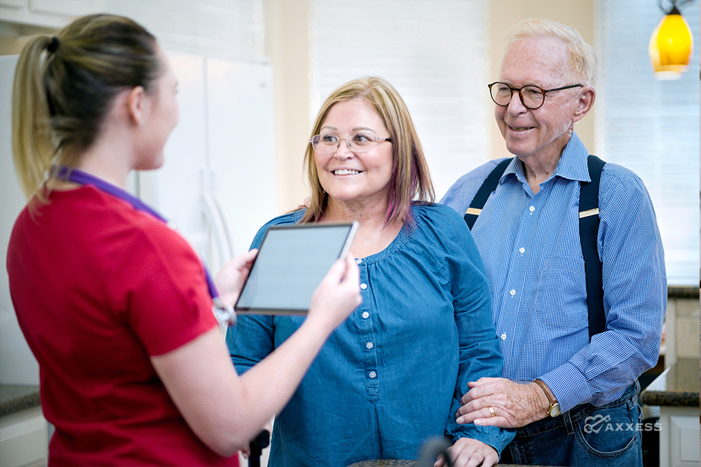 a nurse discussing pdgm home health with patients