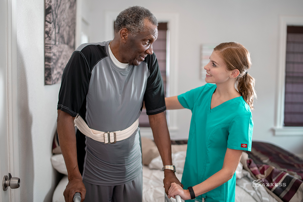 Nurse using home health software to comply with PDGM requirements