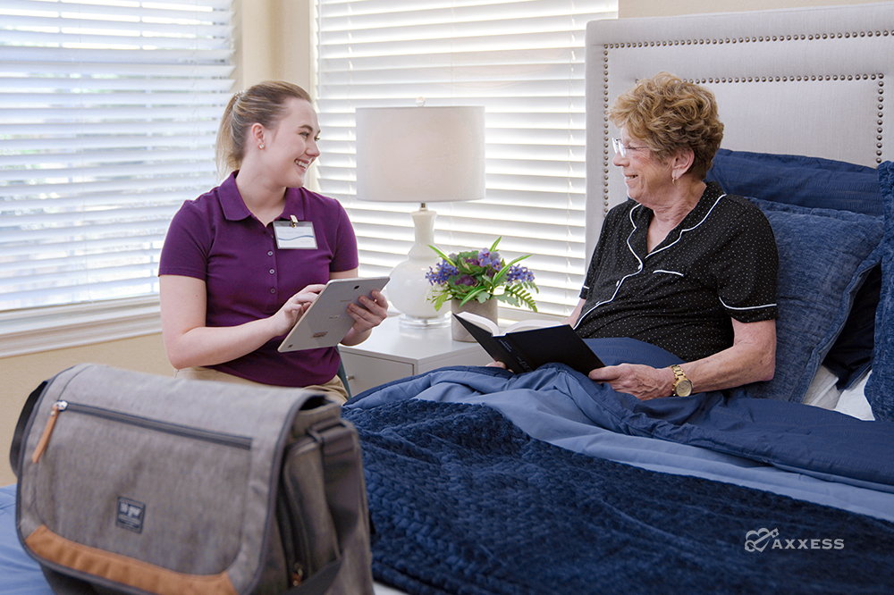 Nurse using hospice software to document values, beliefs, and spiritual concerns