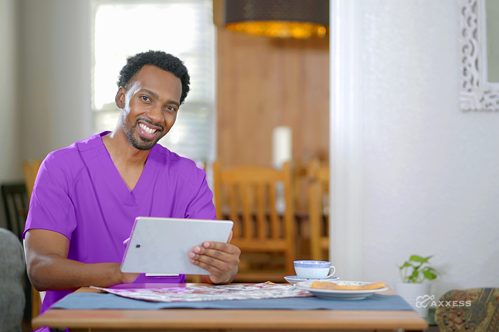 Nurse using hospice software